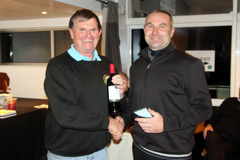 "Nick Holt of ""Light Relief"" receives his ""Nearest the Pin"" Trophy from BNRC President Graham"